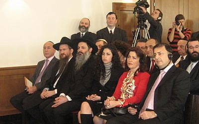 Lev Leviev, front right, listening to a ceremony marking the opening of a Chabad center in Vienna, is seated next to his wife and daughter. One of Russia's chief rabbis, Berel Lazar, is second from left, Feb. 18, 2007. (Dinah A. Spritzer via JTA)