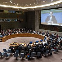 The Security Council Chamber as Zeid Ra'ad Al-Hussein (shown on screen), UN High Commissioner for Human Rights, addresses via video conference the Council's open debate on the victims of attacks and abuses on ethnic or religious grounds in the Middle East on March 27, 2015, in New York. (UN photo)