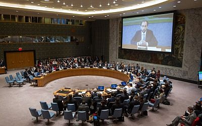 A view of the Security Council Chamber as Zeid Ra'ad Al-Hussein (shown on screen), UN High Commissioner for Human Rights, addresses via video conference the Council's open debate on the victims of attacks and abuses on ethnic or religious grounds in the Middle East on 27 March 2015 in New York. (UN photo)