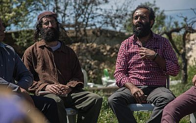 An Israeli settler and Palestinian sit with the Fact Finders group at the Roots tent near Gush Etzion and discuss peace and coexistence