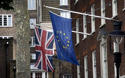 A European Union, right, and Union flags are displayed outside Europe House, the European Parliament's British offices, in London, Wednesday, June 22, 2016.  (AP Photo/Matt Dunham)