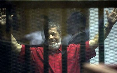 Former Egyptian president Mohammed Morsi in a makeshift courtroom at the national police academy, in Cairo, Egypt, Saturday, June 18, 2016. (AP/Amr Nabil)