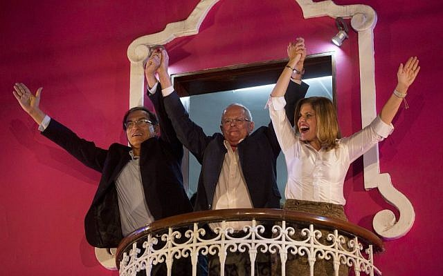 Presidential candidate Pedro Pablo Kuczynski, center, celebrates with his running mates for first and second vice-presidents Martin Vizcarra and Mercedes Araoz, from the balcony of their headquarters in Lima, Peru, June 5, 2016. (AP Photo/Rodrigo Abd)