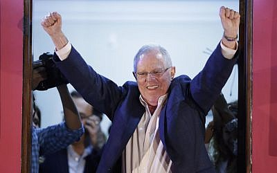 Presidential candidate Pedro Pablo Kuczynski celebrates from the balcony of his headquarter in Lima, Peru, June 5, 2016. (AP Photo/Martin Mejia)