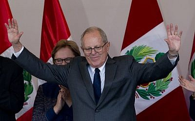 Pedro Pablo Kuczynski acknowledges the crowd at the end of a news conference in Lima, Peru, Thursday, June 9, 2016. Kuczynski won the majority of votes in the country's closest presidential contest in five decades, Peruvian electoral authorities said Thursday. (AP Photo/Silvia Izquierdo)