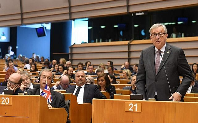 European Commission President Jean-Claude Juncker speaks during a special session of European Parliament in Brussels, June 28, 2016. At front second left is UKIP leader Nigel Farage. (AP Photo/Geert Vanden Wijngaert)