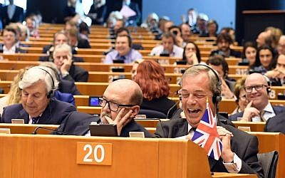 Leader of the UKIP Nigel Farage, front right, attends a special session of European Parliament in Brussels, June 28, 2016. (AP Photo/Geert Vanden Wijngaert)