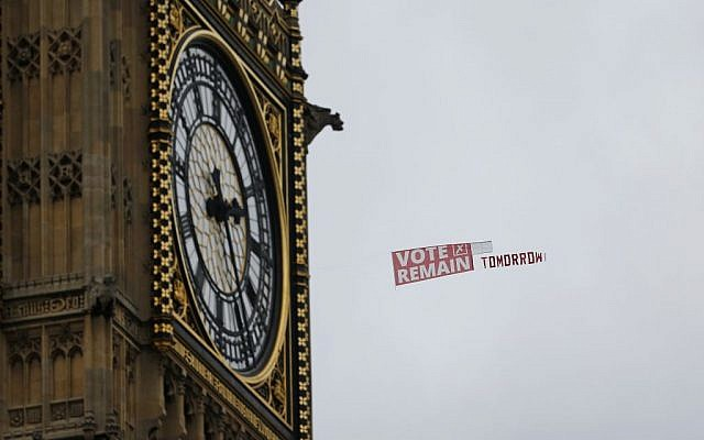 A pro-EU banner being towed behind a plane, passes the clock commonly known as Big Ben in Elizabeth Tower in the Houses of Parliament in London, Wednesday June 22, 2016 on the final day of the EU referendum campaign before Britain goes to the polls to vote on continuing its membership of the EU. (AP Photo/Alastair Grant)