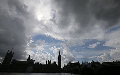 Clouds gather above the Houses of Parliament on the banks of the River Thames following the EU referendum result, London, Saturday, June 25, 2016. Britain voted to leave the European Union after a bitterly divisive referendum campaign. (AP Photo/Tim Ireland)
