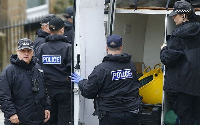Police continue to search the crime scene in Birstall, West Yorkshire, England Friday, June 17, 2016 the day after Labour MP Jo Cox was murdered in the street outside her constituency advice surgery. (Danny Lawson/PA via AP)