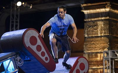 "Akiva Neuman, an Orthodox Jew who is studying to be a rabbi, competing in the Philadelphia qualifying round of ""American Ninja Warrior."" (Mitchell Leff/NBC via JTA)"