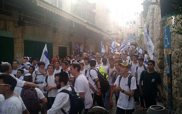 Jewish nationalists marching through the Muslim Quarter of the Old City on June 5, 2016. (Judah Ari Gross/Times of Israel)