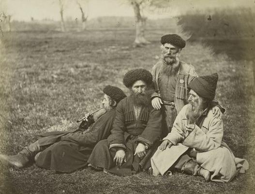 Circa-1898 photo of Mountain Jews resting after a day's work. (Public domain)