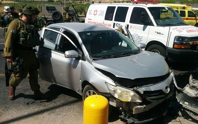 Israeli couple's car after it was struck by another vehicle driven by a Palestinian woman in a possible terror attack at the entrance to Kiryat Arba in the West Bank on June 24, 2016. (Magen David Adom)