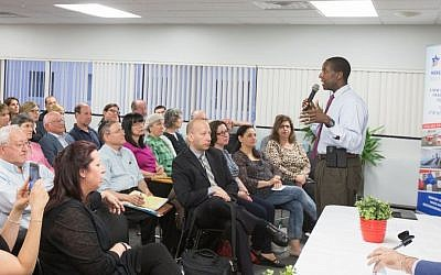 During a June 14, 2016 gathering in Newton, Massachusetts, the city's mayor, Setti Warren, addresses the audience about a recent series of anti-Semitic incidents in Newton schools (Elan Kawesch/The Times of Israel)