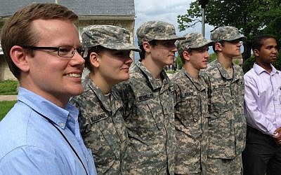 In this May 23, 2016 photo, Maryland School for the Deaf government and history teacher Keith Nolan, left, stands at attention with school Cadet Corps members, left to right, Jennida Willoughby, Maverick Obermiller, Blake Brewer and Kiser Holliday, and school audiologist David Alexander in Frederick, Maryland. Nolan wants the Defense Department to allow deaf people to enter the armed services. (AP Photo/David Dishneau)