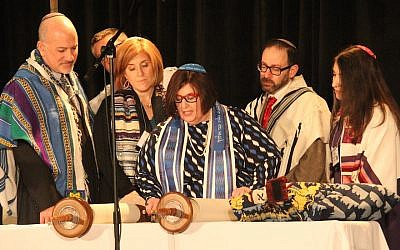 Rabbi Denise Eger, center, reading Torah during her installation as president of the Central Conference of American Rabbis, March 16, 2015. (David A.M. Wilensky)