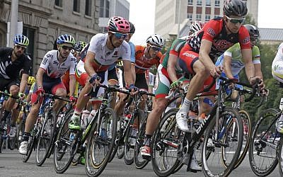In this Sept. 27, 2015, file photo, Taylor Phinney, right, of the United States, rides during the men's elite road circuit cycling race at the UCI Road World Championships in Richmond, Va. (AP Photo/Gerry Broome, File)
