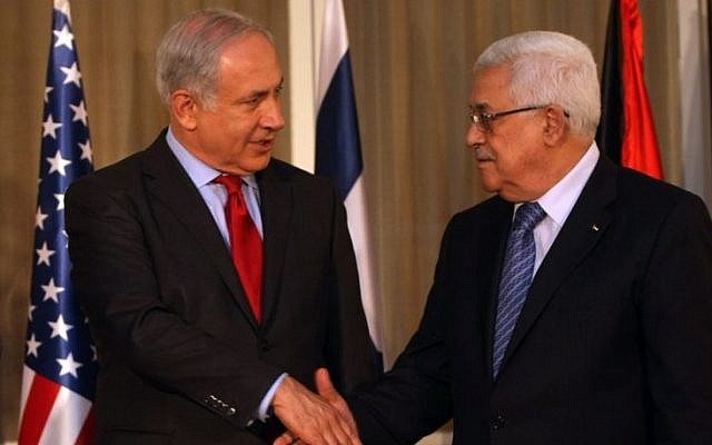 Prime Minister Benjamin Netanyahu shakes hands with Palestinian Authority President Mahmoud Abbas in Jerusalem, September 15, 2010. (Kobi Gideon/Flash90)