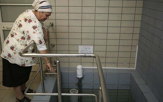 Illustrative photo of a ritual bath attendant, a woman who checks that the immersion in the bath is kosher according to the Jewish tradition. (Hadas Parush/Flash 90)