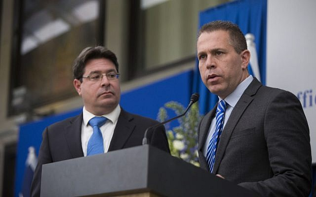 Likud MKs Ofir Akunis (L) and Gilad Erdan speak to press after meeting with Israeli president Reuven Rivlin at the president's house in Jerusalem on March 22, 2015 (Yonatan Sindel/FLASH90)