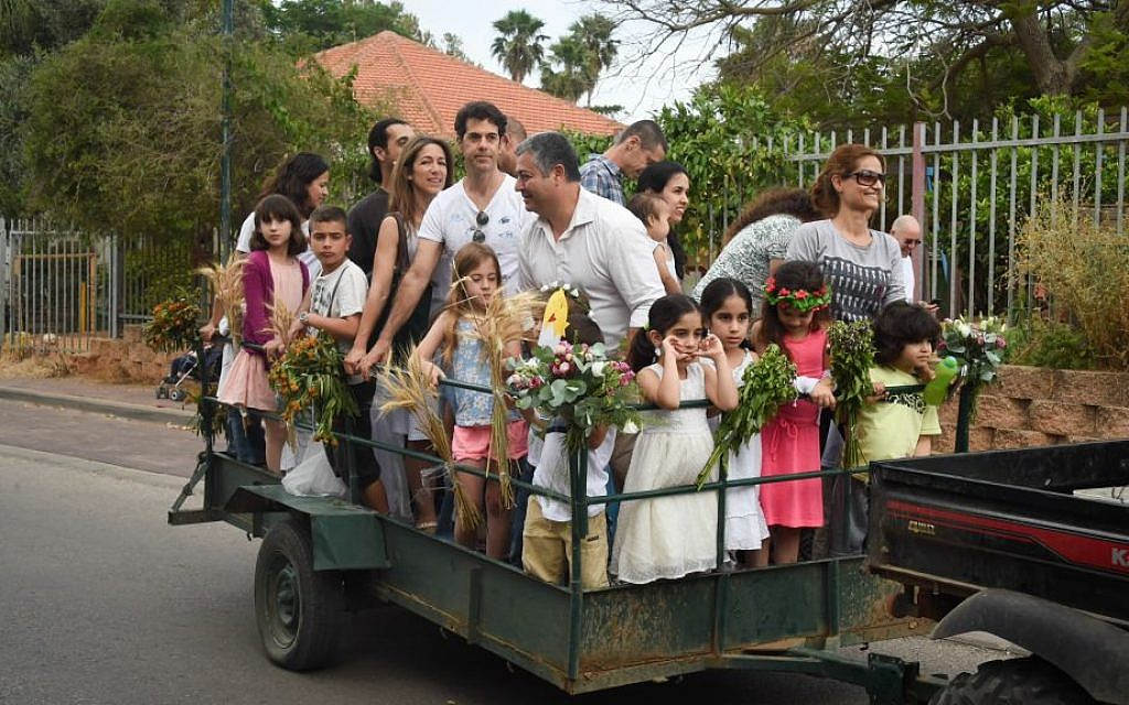 There's more than one way to celebrate Shavuot; a cartful of celebrants at Moshav Kfar Hess, Shavuot 2015 (Courtesy Flash 90)