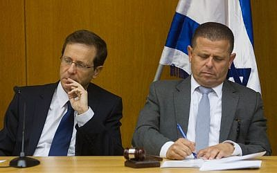 Zionist Union leader Isaac Herzog (L) and MK Eitan Cabel attend a faction meeting at the Knesset on June 8, 2015 (Miriam Alster/Flash90)