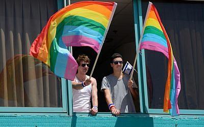 Hanging out the Gay Pride flags in Tel Aviv at the 2015 Gay Pride parade. (Gili Yaari/Flash90)