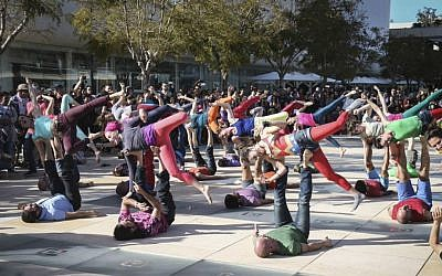 Israelis practice yoga at Habima Square in March 2016 (Courtesy Flash 90)