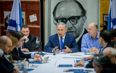 Benjamin Netanyahu, center, holds a Likud faction meeting in front of a photo of former party leader Menachem Begin at the Begin Heritage Center in Jerusalem on March 14, 2016. (Yonatan Sindel/Flash90)