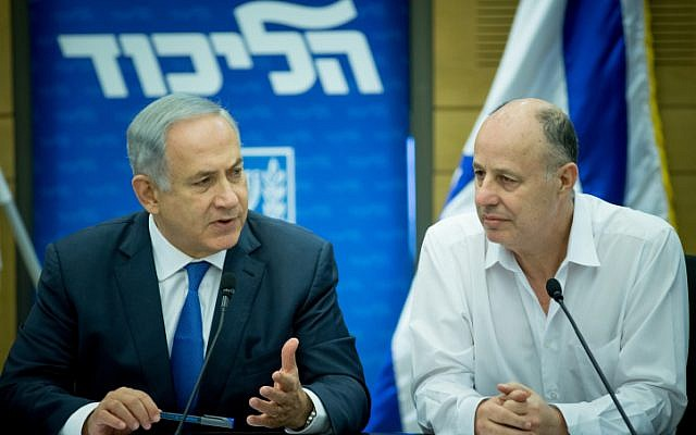 Prime Minister Benjamin Netanyahu with MK Tzachi Hanegbi (R) at the weekly Likud party meeting at the Knesset on March 28, 2016. (Yonatan Sindel/Flash90)