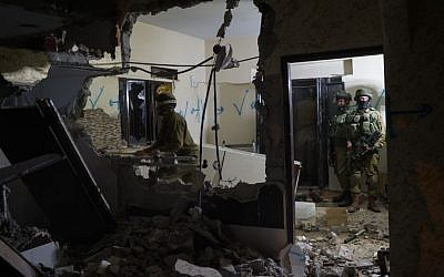 A file photo of Israeli soldiers demolishing the West Bank home of a terrorist in March, 2016 (IDF Spokesperson)