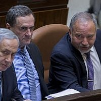 Prime Minister Benjamin Netanyahu, left,  Transportation Minister Israel Katz, center, and Defense Minister Avigdor Liberman in the Knesset, Jerusalem, May 30, 2016. (Yonatan Sindel/Flash90)