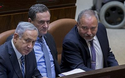 Prime Minister Benjamin Netanyahu, left,  Transportation Minister Israel Katz, center, and Defense Minister Avigdor Liberman in the Knesset, Jerusalem, May 30, 2016. (Yonatan Sindel/Flash90)