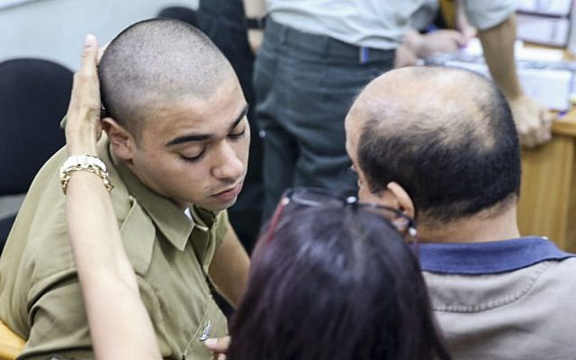 IDF Sgt. Elor Azaria appears in Jaffa military court on June 1, 2016, for the first day of testimony in his manslaughter trial for shooting a disarmed Palestinian attacker in Hebron in March. (Flash90)