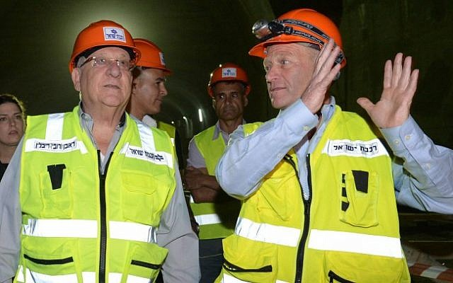 President Reuven Rivlin, left, with Fast Lane director Dror Sofro on June 1, 2016 during a tour at the construction site of the new high-speed train between Jerusalem and Tel Aviv. (Mark Neyman/GPO)