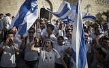 Illustrative: Thousands of mostly young, Jewish teenagers wave Israeli flags as they march through the Damascus Gate and into the Muslim Quarter on their way to the Western Wall to celebrate Jerusalem Day on June 05, 2016. (Hadas Parush/Flash90)