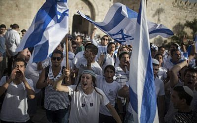 Thousands of mostly young, Jewish teenagers wave Israeli flags, as they march through the Damascus Gate and into the Muslim Quarter, on their way to the Western Wall to celebrate Jerusalem Day on June 5, 2016. (Hadas Parush/Flash90)