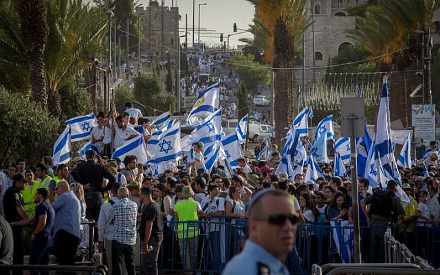 Thousands of young Jewish boys wave Israeli flags as they celebrate Jerusalem Day, dancing and marching their way through Damascus Gate to the Western Wall, on June 05, 2016. (Nati Shohat/Flash90)