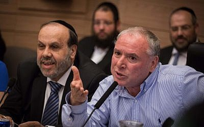 Religious Affairs Minister David Azoulay (Shas, left) and MK David Amsalem (Likud) at the Internal Affairs Committee meeting on a proposed law to change regulations at ritual baths, on June 6, 2016. (Hadas Parush/Flash90)