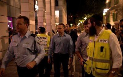 Public Security Minister Gilad Erdan tours the site of a deadly terror attack in Tel Aviv on June 8, 2016 (Ben Kelmer/Flash90)
