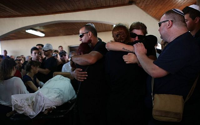 Family and friends at the June 9, 2016 funeral of Ido Ben Ari, 42, in Yavneh. Ben Ari died in the Sarona Market terror attack in Tel Aviv the day before. (Miriam Alster/Flash90)