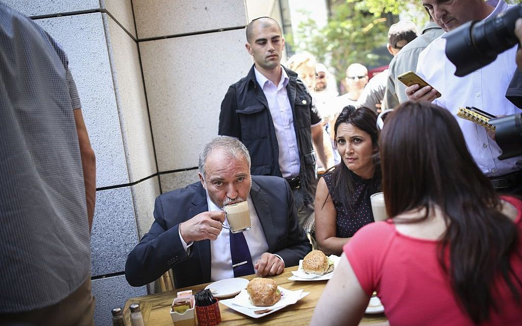 Defense Minister Avigdor Liberman shows his support drinking coffee at Sarona Market shopping center in Tel Aviv, on June 9, 2016. (Miriam Alster/Flash90)