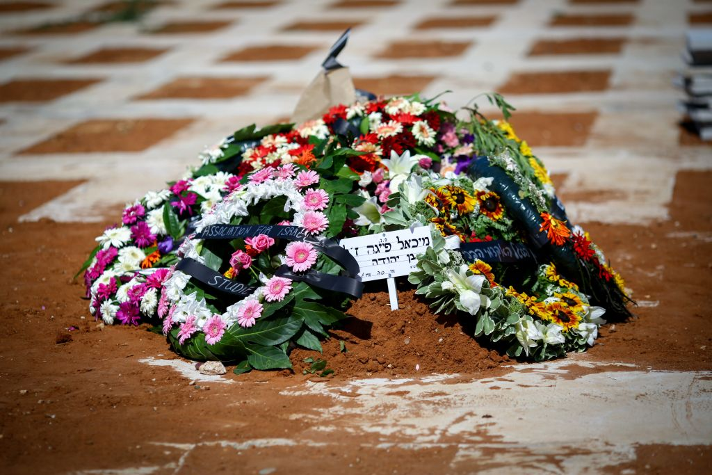 Flowers placed on the grave of Michael Feige, following his funeral at the cemetery in Rehovot, June 10, 2016. Feige was one of four Israelis killed in a terror shooting attack at the Sarona market in central Tel Aviv, June 8, 2016 (Photo by FLASH90)