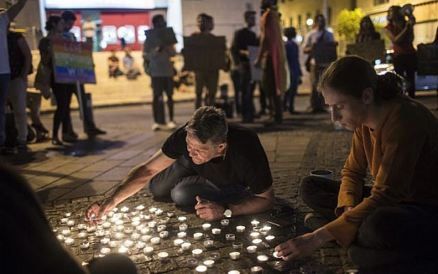 Young Israeli LGBT activists light candles as they gather at Zion Square in Jerusalem in solidarity with the victims of the shooting attack (Hadas Parush/Flash90)