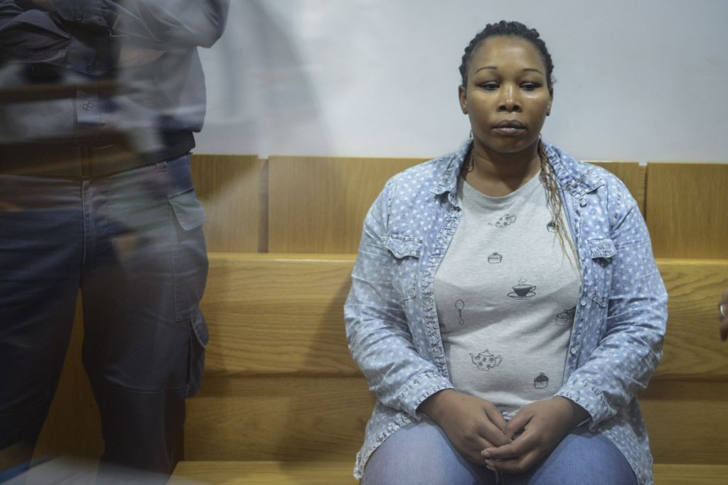 Felisia Eyalti Vana seen at the Nazareth District Court on June 19, 2016, where she was charged in connection to the murder of her mother-in-law Miriam Ayalti. (Basel Awidat/Flash90)