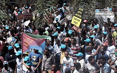 Eritrean migrants protest in front of the European Union embassy in Ramat Gan, calling for the UN to try the Eritrean leadership for crimes against humanity, on June 21, 2016. (Tomer Neuberg/Flash90)
