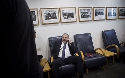 Avigdor Liberman speaks on the phone during the weekly cabinet meeting at the Prime Minister's Office in Jerusalem on June 26, 2016. (Miriam Alster/FLASH90)