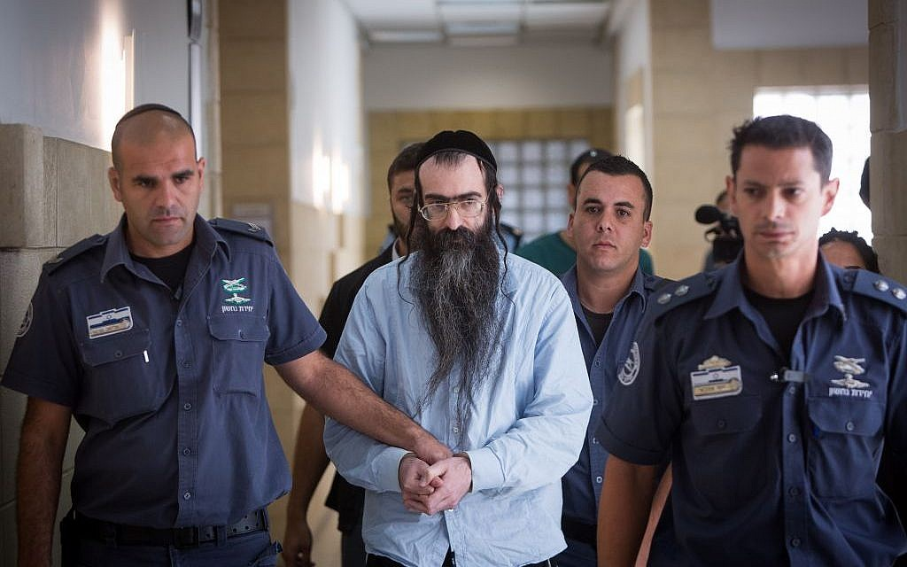 Gay pride stabber Yishai Schlissel is led out of the courtroom, at the Jerusalem District Court on June 26, 2016, after being sentenced to life in prison and an additional 31 years (Yonatan Sindel/Flash90)