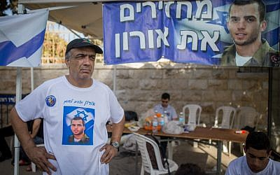 Herzl Shaul, father of late Israeli soldier Oron Shaul, stands at the protest tent outside the Prime Minister's Residence in Jerusalem on June 26, 2016 (Yonatan Sindel/Flash90)